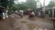 তানোরে ভাঙ্গা রাস্তার গর্তে পানি জমায় চলাচলে দূর্ভোগ
